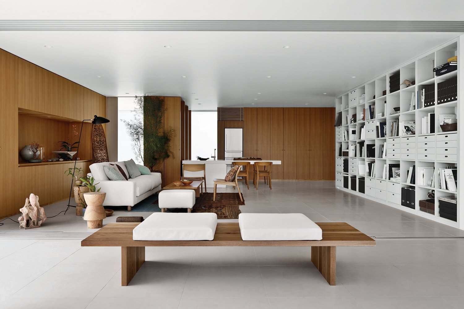 The interior is a spatially open layout with a flexible DIY storage system that supports the ceiling.  127+ Inspiring Interior Ideas from Q&A with Japanese Architect Shigeru Ban