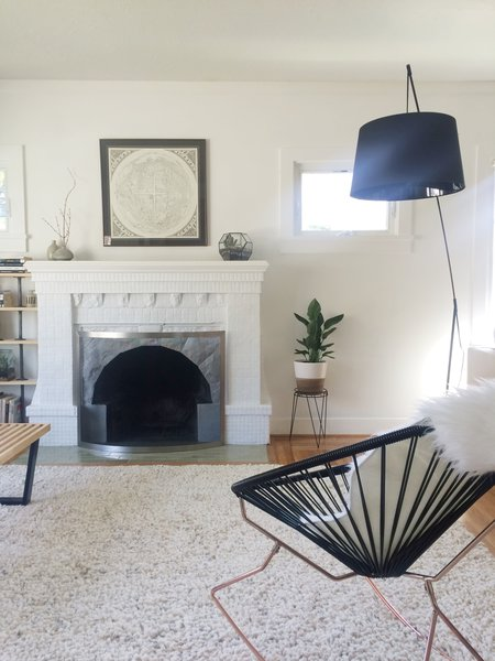 Alexandra Young's Craftsman-style bungalow in Oakland testifies to the wisdom of patiently accumulating a collection over many years. An ornate masonry fireplace fits easily into the home's historical mood, but like other rooms in the house, it has been updated with a modern fire screen.