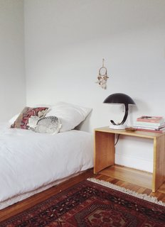 In addition to her beloved midcentury style, Young developed an appreciation for Scandinavian design while abroad in Europe in her twenties, evident in the pared-down bedroom.