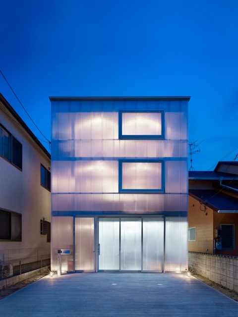 Exterior, Flat RoofLine, and House Building Type A glowing home in Japan has milky-white, one-and-a-half-inch plastic sheets wrapped around the exterior to let in light and provide insulation.  Photos from The Home That Glows in the Dark