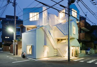 Resembling a jumble of houses piled on top of one another, this dynamic apartment building designed by the architect Sou Fujimoto evokes the chaos and crowding of its setting, Tokyo. Adding to the complexity, the units do not correspond to the house forms. Instead, stairs and ladders link individual tenant spaces that span the different pitched-roof volumes. The building sits on a corner in a residential neighborhood.