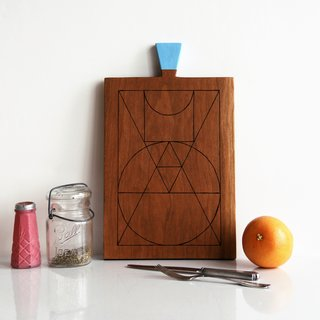 GEOMETRIE III - CHERRY SERVING BOARD $175.00  This super hip, hand-carved, and hand-engraved geometric serving board by Amelie Mancini is perfect for an appetizer or cheese course. This particular board is sold out but can be commissioned by emailing Amelie at amelie.mancini@gmail.com