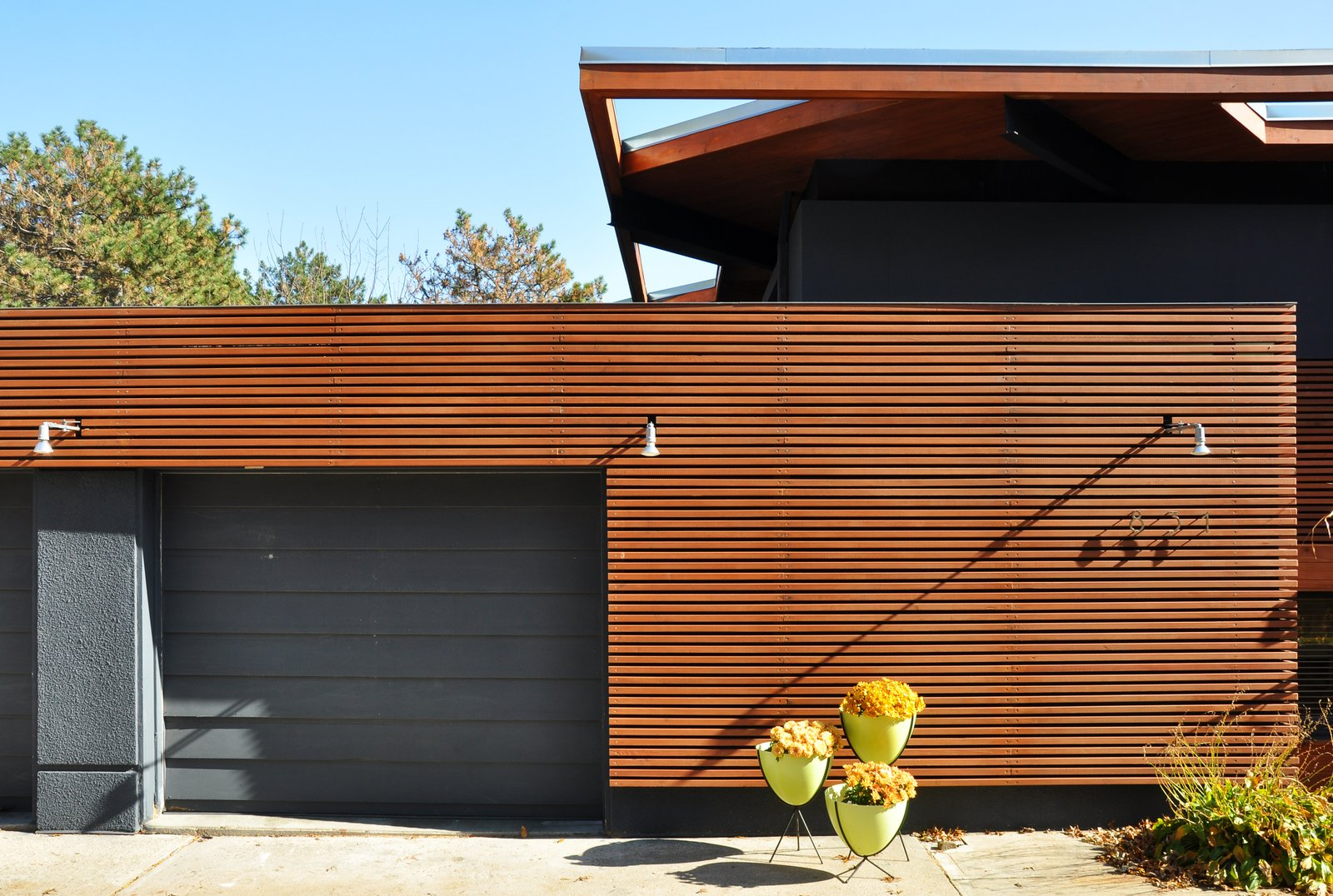 "Exterior, House Building Type, and Wood Siding Material Designed in 1960, the house was originally a lodge to accommodate horse trails. Throughout the years, the house has expanded with various additions and renovations.  Search ""modern home young hollywood"" from A Couple Reclaims Bowling Alley Floors for Their Family's Bedrooms and Even Saves Some for a Custom Bench"