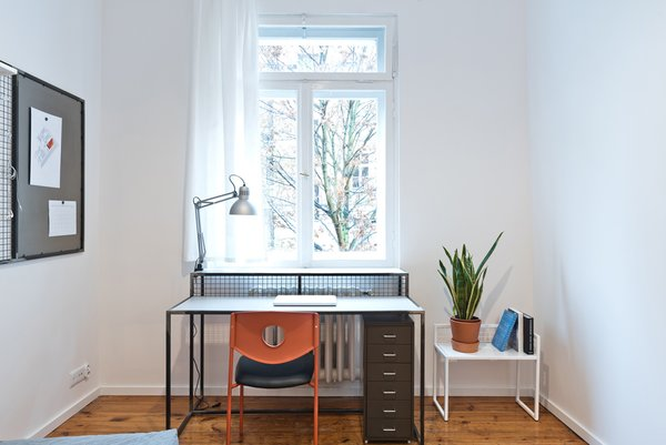 Each student room has a dedicated workspace that's clean, bright, and functional. Objects and furniture had to be carefully selected or designed to make the apartment work: for instance, the steel desk was custom designed by Wierciński's firm to double as a radiator cover.