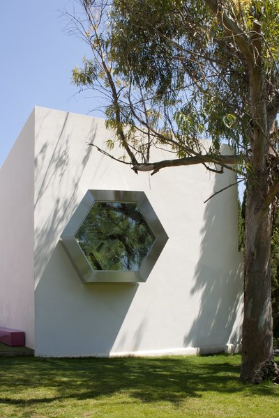 From the exterior, the kaleidoscope is unassuming enough: a hexagonal window protruding from an simple rectangular building.