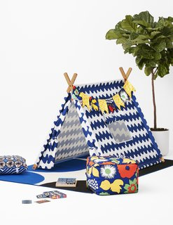 The collection includes a Play Tent, seen here in a Lokki print, along with accessories like pillows, poufs, towels, and a memory card game.