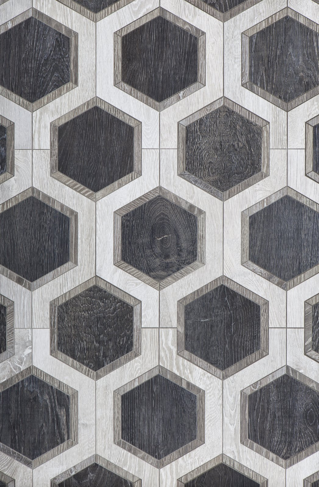 From Walker Zanger, Sterling Row Hexagon, a wood-finish ceramic tile.  New Kitchen and Bath Surfaces We Love by Erika Heet