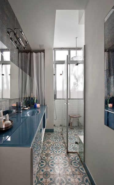 In the bathroom, Reik hand-made the tiles and also the blue glass cabinet that holds the sink.