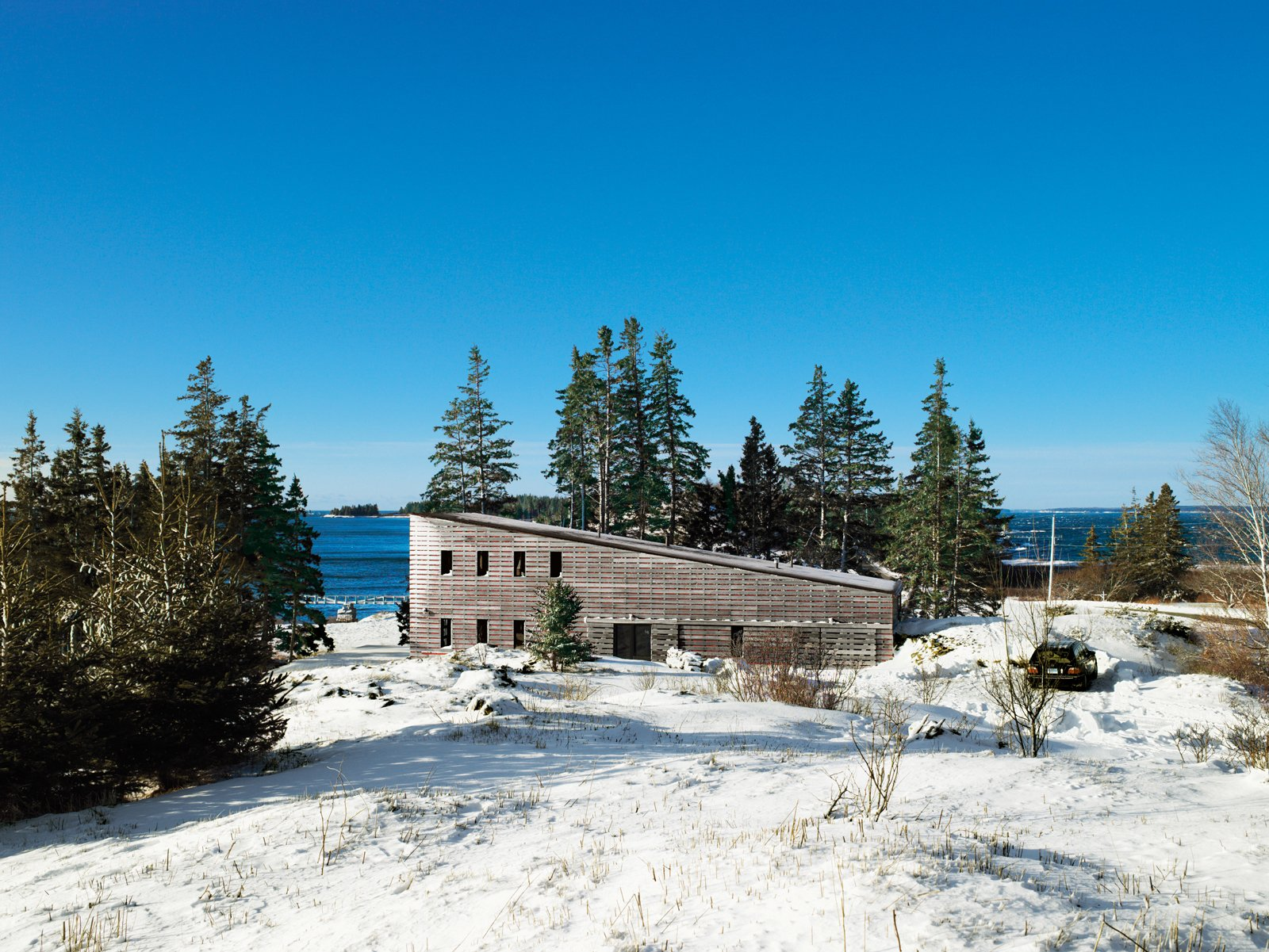 """North Haven locals nonplussed by Bobbie Callahan and Ed Hayes's unusual retreat lit upon its cinematic qualities, calling it """"the Strand"""" after the nearest movie theater on the mainland. Tagged: Exterior, Cabin Building Type, Shed RoofLine, and Wood Siding Material.  Photo 1 of 10 in A Northern Haven"""