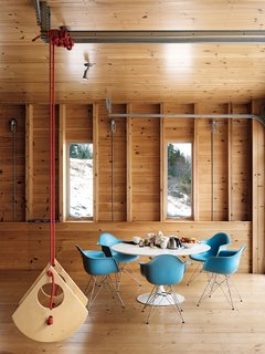 Campbell's Little Bird swing flies high alongside modern classics like the Eames shell chairs and Saarinen Tulip table.