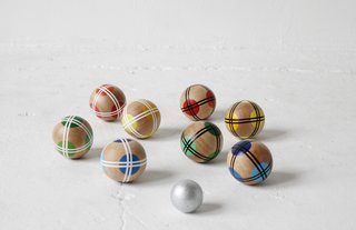 Bocce set by Fredericks and Mae, $320 at fredericksandmae.myshopify.com  Featuring hand-painted wooden balls, a jack, and a carrying bag, this elevated bocce set is a keepsake that kids can enjoy well into adulthood. (Check out more modern games we love here.)