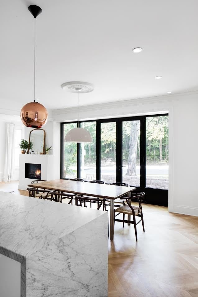 Dining Room, Table, and Chair Copper Shade Pendants by Tom Dixon over the island contrast the room's light palette, while a white Flos Skygarden lamp over the dining room table blends into it.  Ideas for reno from This House Looks Great After 107 Years