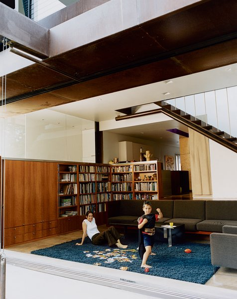 Angela Brooks and son Calder revel in the benefits of free solar energy, cheerfully opening the living room's big glass doors when it's time to play.