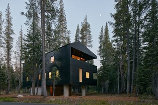 The exterior timber cladding is coated with black tar, a traditional Norwegian treatment. The finish serves a variety of purposes: solar heat gain, water resistance, and insect repellant.
