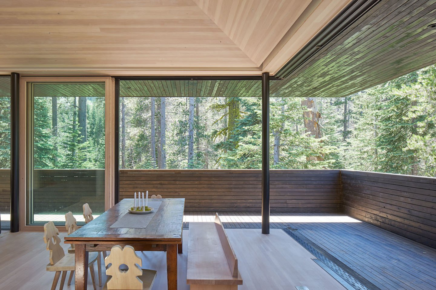 Imported Tyrolean dining chairs and a custom bench designed by Lexie pair well with the family's antique leaf table under the Douglas Fir ceiling.  Photo 6 of 7 in Here's What Norse Mythology and Modern Architecture Have in Common