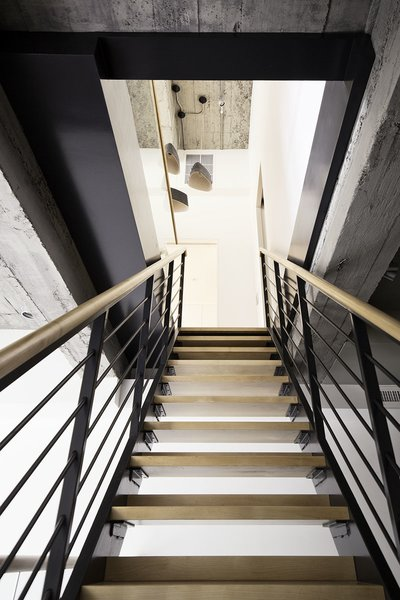 """Although the two apartments were stacked vertically, their individual systems and layout were quite different. The limited horizontal overlap meant that the owners and design team had to give careful thought to the connective elements, and how the family would ultimately circulate through the home. One of the key pieces to the puzzle was finding a place for the interior stairs. Says Bangia Agostinho principal Anshu Bangia, """"There was a challenge to find an appropriate location to cut a new stair opening between the apartments, and then have the new stair coordinate with the existing one to form a logical sequence of circulation between the three levels."""""""