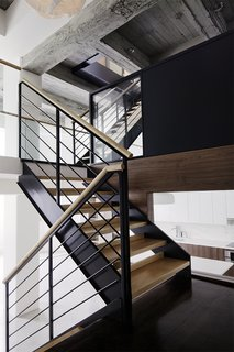 """The switchback stairs create a circulation pattern that, according to Bangia, is """"noticeably different than what you would find in a typical Brooklyn town house."""" She adds, """"It lends an element of surprise when moving between floors, and a dynamic spatial sense of expansion and contraction."""""""