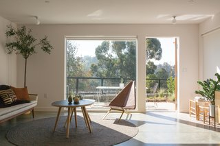 """In the Echo Park neighborhood of Los Angeles, architect Barbara Bestor designed Blackbirds, a multi-family housing development with 18 detached and semi-detached homes ranging from 1,400 to 1,900 square feet each. Bestor says she approached the project with a strategy towards """"stealth density,"""" attuned to the scale and context of the neighborhood. """"I have a romantic idea about individuals densifying L.A. as opposed to large developers doing twnety blocks at a time,"""" she says. Spacious interiors open up to expansive views of the hills beyond."""