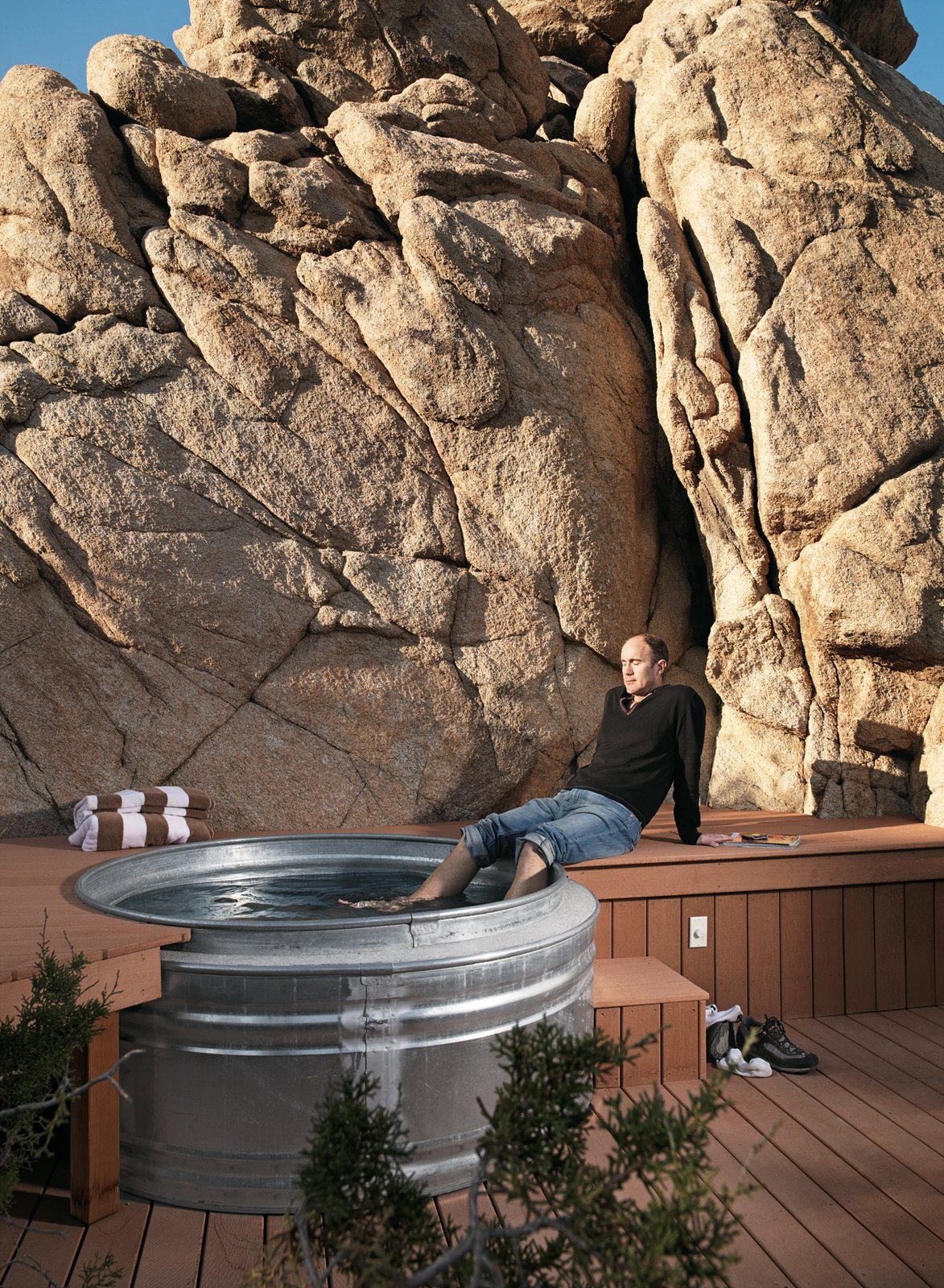 "Nighttime hikes often end at the the ""cowboy"" hot tub where Smith soaks his feet: two nested Hastings galvanized livestock feeders. The tub is surrounded by a Veranda faux-wood deck and fed with hot water from the house's solar hot-water system.  Tubs"