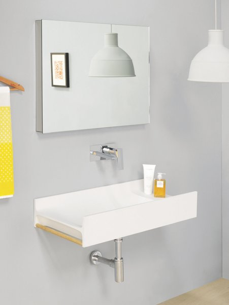 TT washbasin by Meneghello Paolelli Associati for The.Artceram, $1,470  Fixtures can be wall-mounted or installed on the side of this double T-beam–shaped basin. The discreetly placed wooden dowel makes for a space-efficient towel rack.