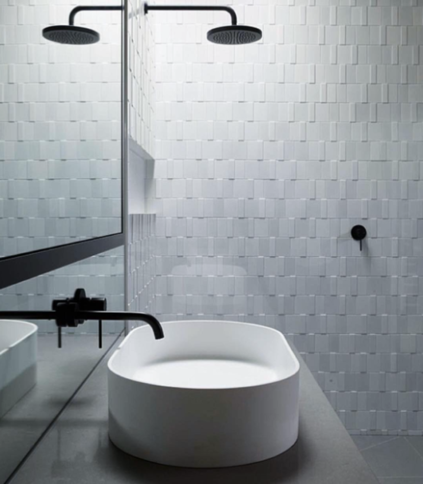 White tile and black fixtures form a striking contrast in another bath.  50+ Modern Tile Ideas for Walls, Floors and Ceilings by William Lamb from Black and White and Minimalist All Over