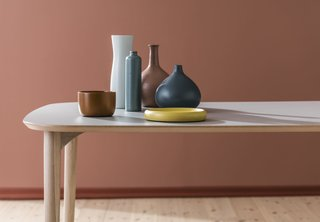 The Flex table features a laminate surface set atop solid-wood legs. The tabletop is avalable in white, light gray, and graphite, and it comes in six dimensions.