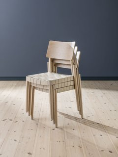 The chairs are stackable with a webbed seat. They come in white, blonde, light gray, and black.