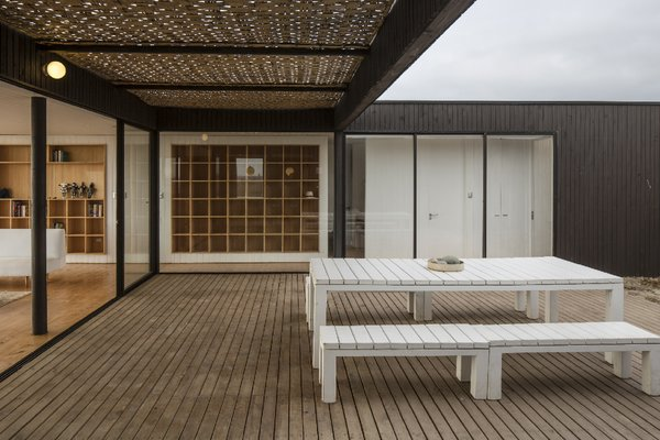 """""""The program of enclosures was developed around a courtyard that is protected from the constant wind. The transparency of the main facade brings the presence of the sea inside the house,"""" LLaumett says."""