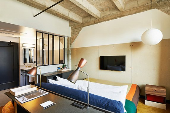 Ace Hotel Downtown Los Angeles, Los Angeles  Ace found a home in the grand 1920s United Artists Theatre building, maintaining its gothic theater and incredible ceilings. Bedrooms are updated, however, with Mondrian-esque bedspreads and globed pendant lights.