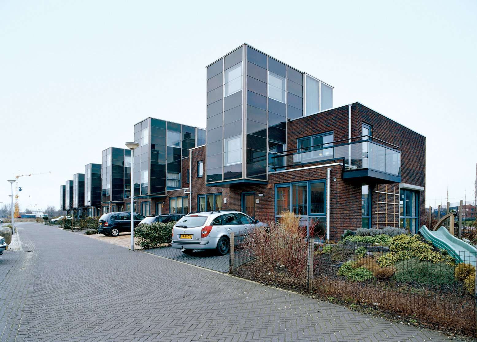 """Arranged and slotted together like a tidy row of Legos, the IJsselstein housing project reflects typical Dutch efficiency, """"not just in terms of materials used,"""" notes architect Gregory Kiss, """"but in terms of space as well.""""  (Nearly) Net-Zero Homes by Erika Heet from Run by the Sun"""