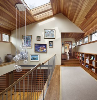 After being damaged by a fire, architect Stephen Moser had the opportunity to design a major renovation of a home in Southern New York using the existing footprint. The renovation included an atrium over the main staircase, which features a custom stainless steel railing designed by Moser and manufactured by the homeowners' son-in-law, who owns a local fabrication shop. The self-supporting steel rod system and Sonneman Bubbles Light pendant light nicely contrast with the surrounding woodwork.
