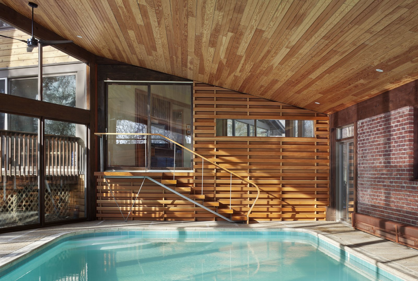 One of the biggest challenges of designing around an indoor pool was managing the humidity, especially with a sloping Douglas fir ceiling. Moser explains that by using a retractable pool cover it helps manage humidity levels. While in the winter there is low humidity, a little actually prevents the wood from drying out.  After a Fire, a Midcentury Home Rises from the Ashes by Caroline Wallis