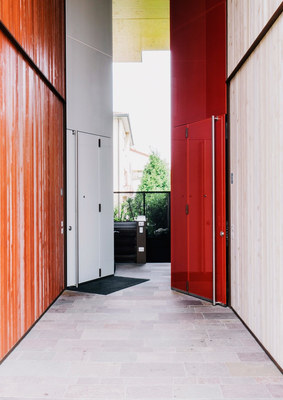 "Hallway and Slate Floor Color is one way the architects differentiated the structures, as in the custom doors they designed for the entrances in contrasting light and dark light finishes.  Search ""aura light"" from Could You Share Your Dream Home?"