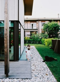 """The homes were designed to maximize the indoor/outdoor experience. """"On long weekends, we sit in the garden, invite friends, and make a barbecue. It's like we've gone on holiday without leaving home,"""" says resident Luca Pagnan."""