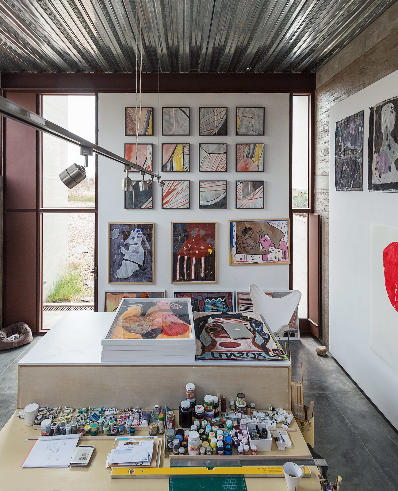 Office and Craft Room Room Type A workspace, bedroom, and bath comprise each of the two studios; an early riser, Lida spends most of the day painting in her space.  Photo 8 of 14 in These Separate Studios Keep a Retired Couple Happy