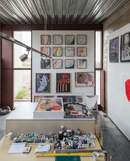 A workspace, bedroom, and bath comprise each of the two studios; an early riser, Lida spends most of the day painting in her space.