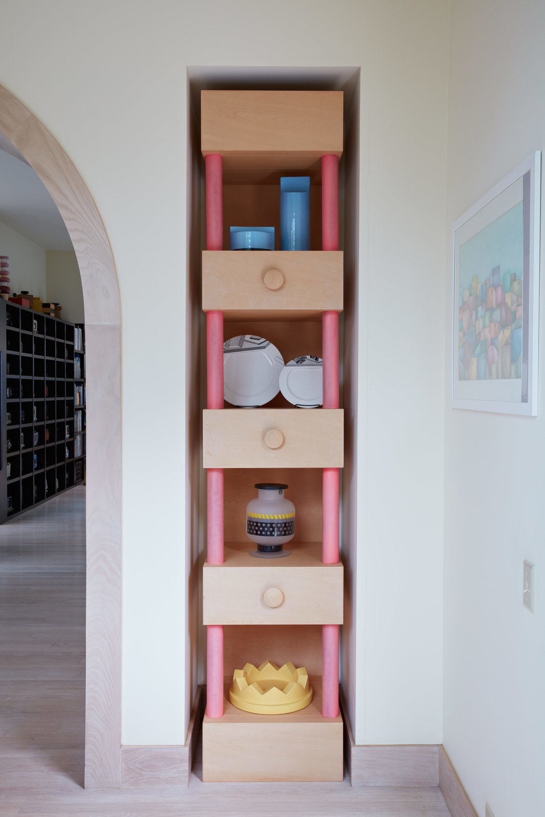 Storage Room and Shelves Storage Type A tall custom niche displays various tabletop items Sottsass designed for brands Habitat, Memphis, Egizia, and Anthologie Quartett.  Photo 5 of 14 in Thank Sottsass for the Most Memphis House Imaginable