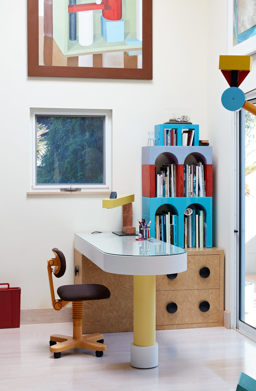 Memphis-style furniture in a home office by Ettore Sottsass