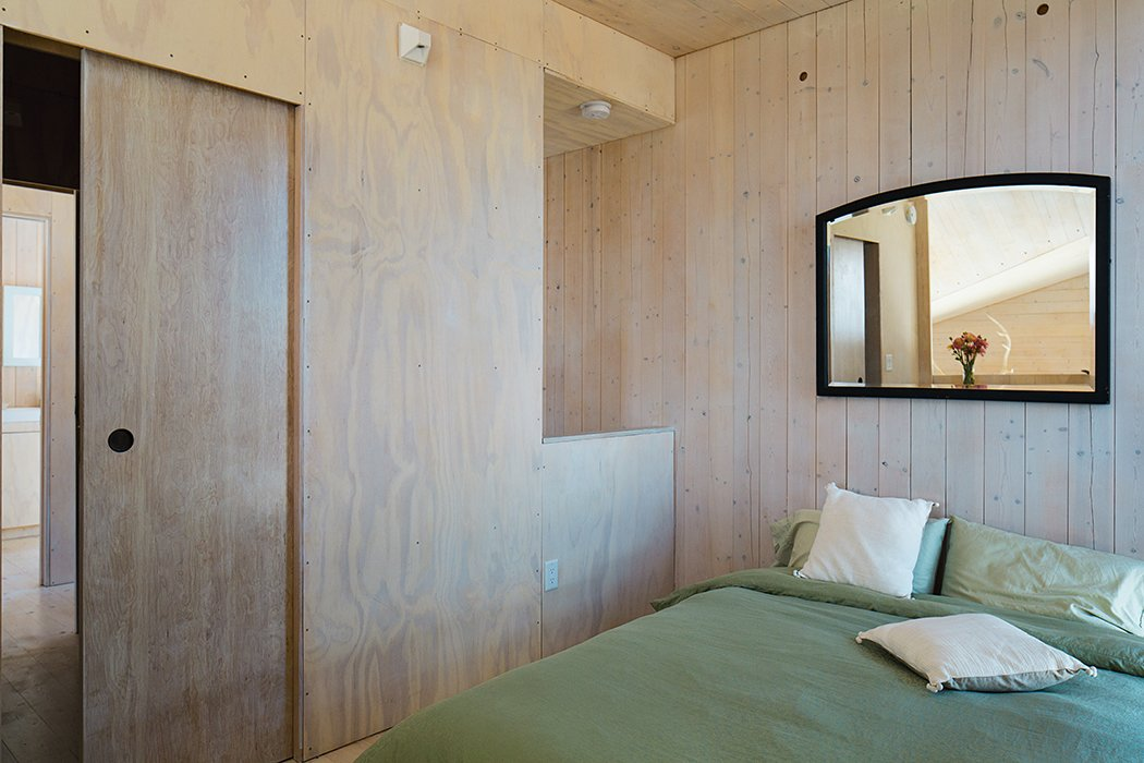 """Bedroom, Bed, and Storage The bedroom is outfitted with only the basics.  Search """"modern lakeside retreat stripped down basics"""" from Learn How to Connect with Nature from This Off-the-Grid Prefab"""