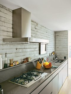 In the kitchen, Silestone countertops were installed above custom plywood cabinets finished with automotive paint.