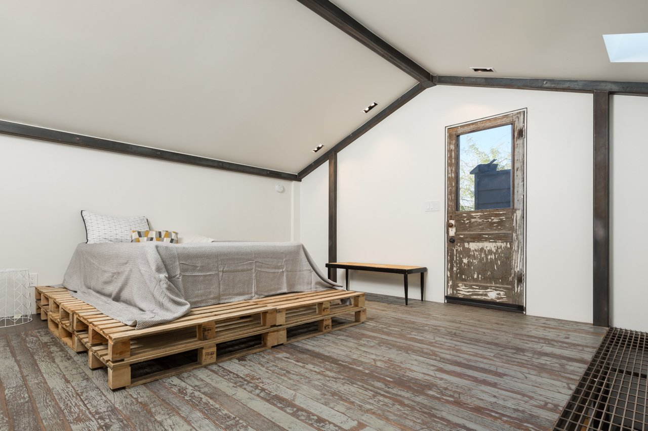 An additional aspect of the renovation was the conversion of a dilapidated carriage house into a sleek, two-story studio that flanks the rear porch. A structural steel frame inside reinforces the structure while recalling the main house's steel cladding.  House of the Week: A Historic House Embraces Modernity by Matthew Keeshin from Amazing House is Half Historic and Half Modern