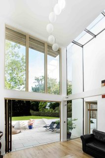 The home's defining quality is its airy, double-height spaces.