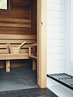 Torrified cedar lines the inside of the rooftop sauna.