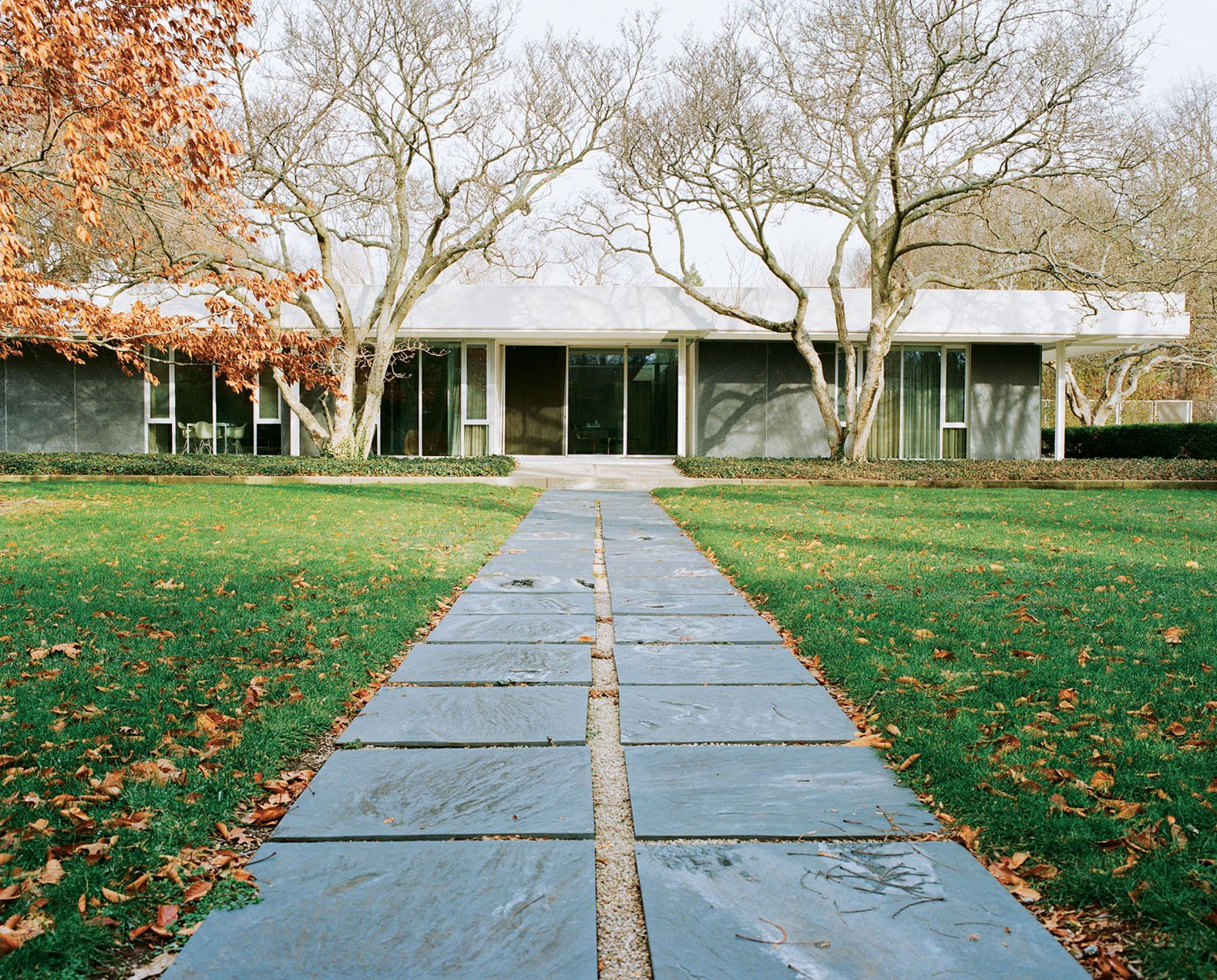 Eero Saarinen's legendary Miller House opened to the public in May 2011 for the first time. The pathway from the pool to the house is paved with the same slate that clads the exterior walls. Photo by Leslie Williamson.  20 Best Modern Homes from the Midwest by Erika Heet from Rooms With a View We Love, Especially in Fall