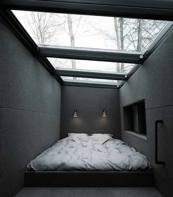 Bedroom A Velux skylight above the sleeping loft includes remote-controlled integrated blinds. The prefab unit can sleep up to four people between the bed loft and the lower-level daybed.  Prefab Gets a Makeover With Danish Industrial Design  by Kelsey Keith
