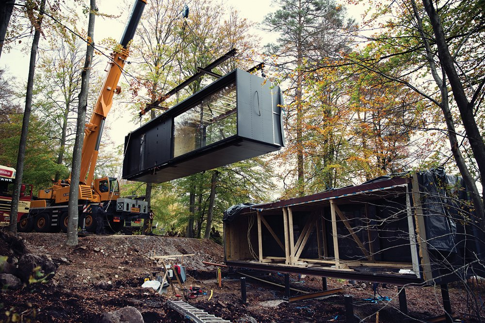 Exterior, House Building Type, Cabin Building Type, Prefab Building Type, Metal Roof Material, Metal Siding Material, and Glass Siding Material It takes three to five days to install a Vipp Shelter onsite.  Best Photos from Prefab Gets a Makeover With Danish Industrial Design