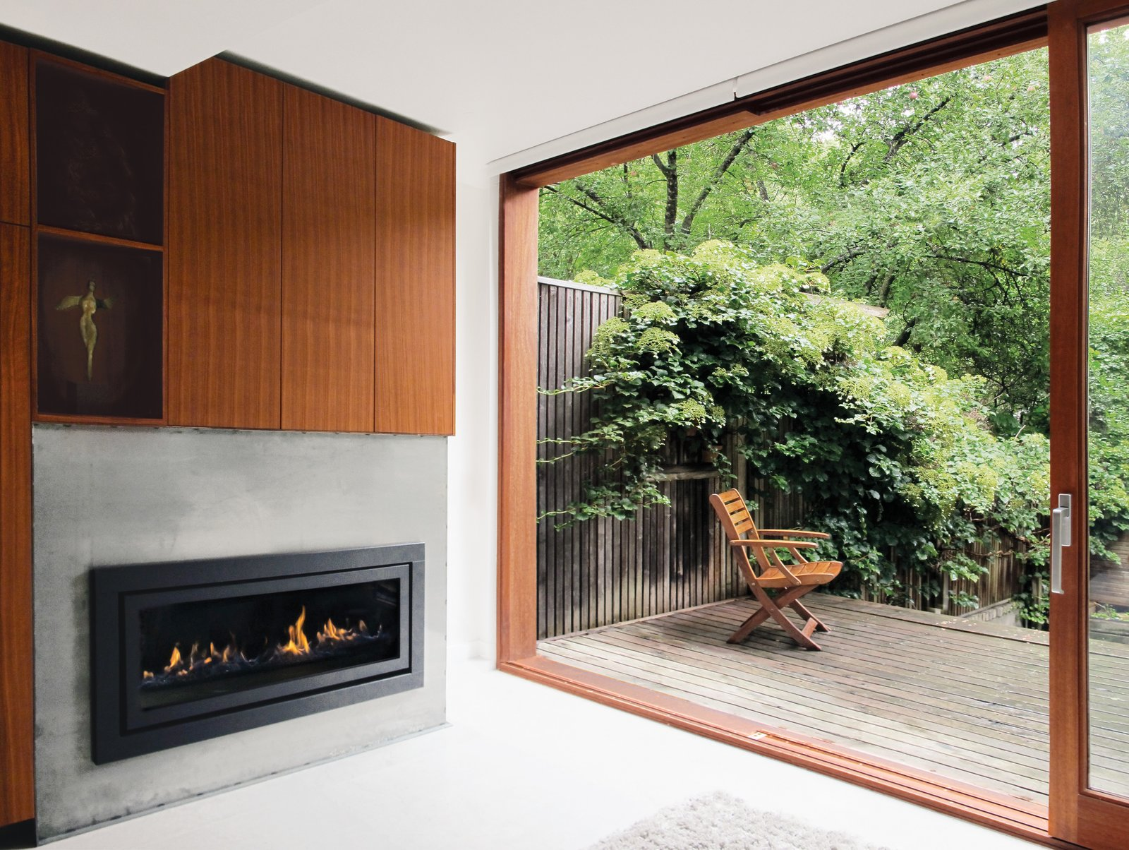Doors, Exterior, Wood, and Sliding Door Type Mandel designed a six-by-eight-foot extension for additional space on the ground floor.  97+ Modern Fireplace Ideas from Reinventing a Traditional Edwardian near Lake Ontario