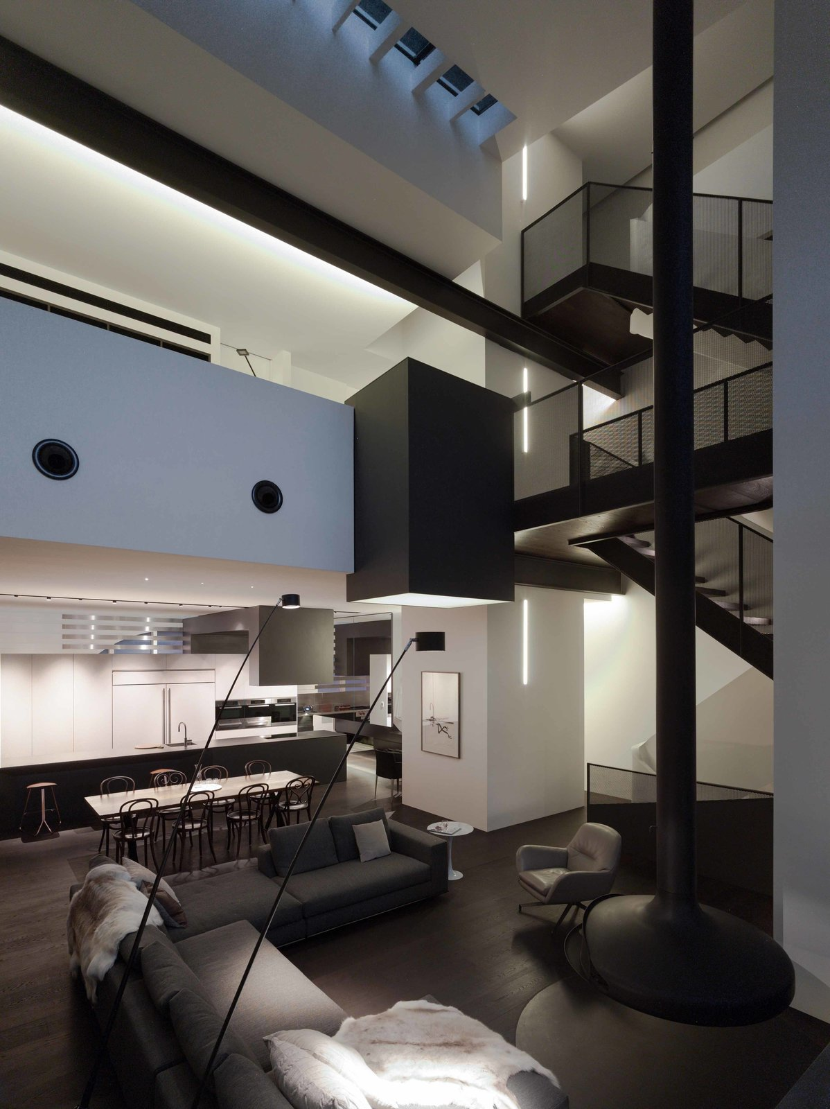 A pivoting Gyrofocus fireplace, staircase, and elevator shaft organize the social space. Lighting throughout the house is mostly ambient, supplemented by task-oriented lighting.  Photo 4 of 7 in An Airy Sydney Home Goes Vertical to Gain Space