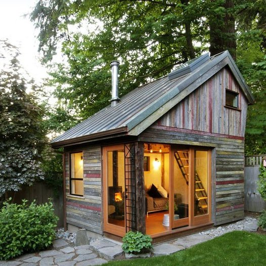 Megan Lea built a backyard retreat with reclaimed materials figuring prominently into the design. What resulted is a polychrome of salvaged 100-year-old barnwood by West Salem-based Barnwood Naturals that makes the facade of this Bernard Maybeck-inspired design as unique as it is environmentally friendly.  One-Room Wonders from Fantastic Backyard Buildings