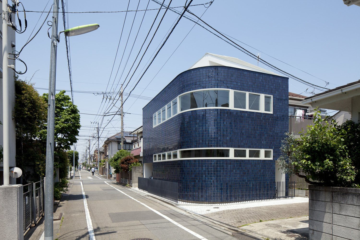"""The blue porcelain tiles covering the house's exterior are typical of commercial buildings of earlier decades. """"It was intended to invoke nostalgia of the past and newness at the same time,"""" lead architect Akio Nakasa says.  Unabashedly Strange Houses in Japan from Bold Japanese Houses"""